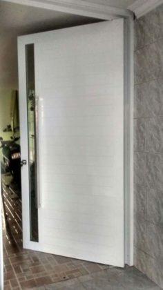 porta pivotante aluminio
