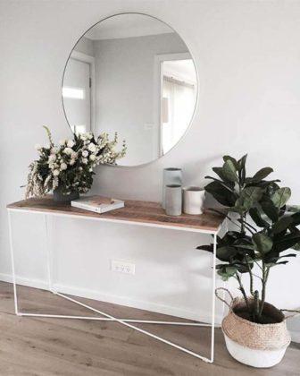 Espelho redondo na sala