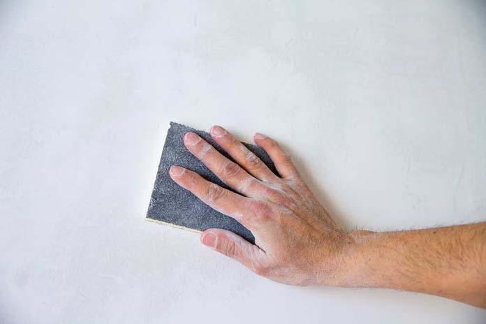 Como lixar a parede