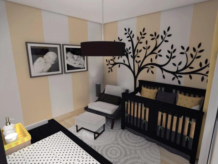 quarto de bebê com paredes brancas e bege, com o berço e cadeiras pretas e brancas