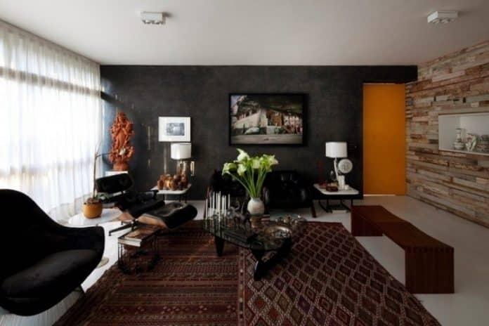 Poltrona e e sofá na cor preto para a decoração da sala